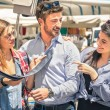 Young tourists at the weekly cloth market - Best friends sharing free time on the weekend having fun and shopping in the old town - Male tie casual fashion — Stock Photo #57387761