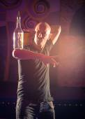 Acrobatic show barman performing exhibition move at night club - Concept of freestyle american bartending in action - Bartender at working in disco party — Stock Photo