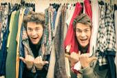 Young hipster brothers at the weekly cloth market - Best friends sharing free time having fun and shopping in the old town in a sunny day - Guys enjoying everyday life moments — Stock Photo