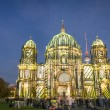 BERLIN, GERMANY - OCTOBER 19, 2014: Berliner Dome illuminated by colorful images during the world famous Festival of Lights. The 2014 event will took place from 10th to 19th october — Stock Photo #58104955