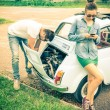 Couple in a moment of troubles during a vintage classic car trip - Concept of modern relationship and interaction with new technologies - Problem solving and lifestyle — Stock Photo #59001069