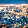 Bokeh of Cape Town skyline from Signal Hill after sunset during the blue hour - South Africa modern city with spectacular nightscape panorama - Blurred defocused night lights — Stock Photo #59284525