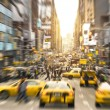 Rush hour with yellow taxi cabs and melting pot people on 7th av. in Manhattan downtown before sunset - Bright blurred defocused postcard of New York City and his crowded traffic jam — Stock Photo #59285167