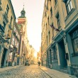 Vintage retro travel postcard of a narrow medieval street in old town Riga at sunset with sun reflection - Latvia - European capital of culture 2014 — Stock Photo #59287271