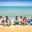 Group of international best friends sitting at beach talking with each other - Concept of multi cultural friendship against racism - Interaction with new technologies tablet and contact with nature — Stock Photo #59287795