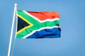 South african flag on a blue sky - Pride of the nation South Africa adopted on 27 April 1994 representing the new democracy — Stock Photo