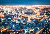 Bokeh of Cape Town skyline from Signal Hill after sunset during the blue hour - South Africa modern city with spectacular nightscape panorama - Blurred defocused night lights — Stock Photo