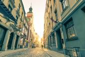 Vintage retro travel postcard of a narrow medieval street in old town Riga at sunset with sun reflection - Latvia - European capital of culture 2014 — Stock Photo