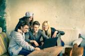 Group of young hipster best friends with computer laptop in urban alternative location - Concept of friendship and fun with new trends and technology - Wireless connection and web internet interaction — Stock Photo