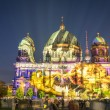 BERLIN, GERMANY - OCTOBER 19, 2014: Berliner Dome illuminated by colorful images during the world famous Festival of Lights. The 2014 event took place from 10th to 19th october. — Stock Photo #59388725