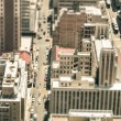Skyscrapers and everyday people life in the business district of Johannesburg - Aerial view of modern buildings of the skyline in South Africa biggest city - Tilted shift defocusing — Stock Photo #59636661