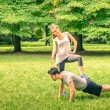 Girlfriend mocking her boyfriend while training in the park - Young man and woman during spring workout and sport activity - Male and female happy couple fitness models exercising after running — Foto Stock #62094141