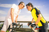 Sport challengers ar bike race - Bicycle competition international world championship - Concept of challenge and loyalty together against doping issues - Two bikers facing each other — Stock Photo