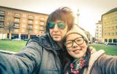 Hipster couple of tourists taking a selfie in Berlin City - Multiracial concept of friendship and fun with new trends and technology - Asian girl with alternative young fashion handsome guy — Stock Photo