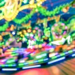 Blurred defocused lights at luna park carousel roundabout - German christmas market at Alexander Platz in Berlin - Fantasy imagery background of childhood fun games and dreams — Stock Photo #62252549