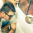 Young handsome man with sunglasses inspecting a vintage car body at second hand trade - Passion and transportation lifestyle of a retro classic vehicles collector — Stock Photo #62252979