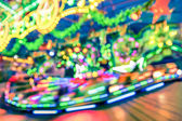 Blurred defocused lights at luna park carousel roundabout - German christmas market at Alexander Platz in Berlin - Fantasy imagery background of childhood fun games and dreams — Stock Photo