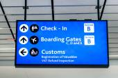 Info sign at international airport - Directions for check in and boarding gates - Registrations and custom at terminal connections — Stock Photo