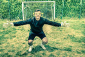 Funny goalkeeper at playground with stupid big empty glasses - Joke concept of blindness with playful attitude approach to sport competition — Foto de Stock
