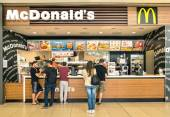 "RIMINI, ITALY - MAY 30, 2014: people waiting for the food service at Mc Donalds desk in the shopping mall "" Le Befane "" . The fast food company was founded in 1940 in San Bernardino, California. — Stock Photo"