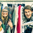 Young hipster couple in love at the weekly cloth market - Best friends sharing free time having fun and shopping in the old town - Lovers enjoying everyday life moments on a vintage filtered look — Stock Photo #62948559