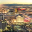 Aerial view of Las Vegas skyline at sunset - Blurred city lights from downtown strip boulevard - Vintage filtered look with radial zoom defocusing — Stock Photo #64303183