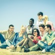 Group of young hipster best friends with digital tablet sitting at the beach - Concept of multi cultural friendship against racism - Interaction with new trends and technologies devices in open spaces — Stock Photo #64303237
