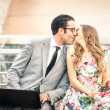 Young hipster couple kissing while sitting with laptop and smartphone - Modern concept of love connected with technology - Business man flirting with beautiful woman in urban financial area outdoors — Stock Photo #64303777