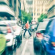 Person crossing the road during rush hour in Cape Town - Concept of connection between people and traffic jam on a vintage filtered look - Radial zoom defocusing of commuter cars on urban city streets — Stock Photo #64499475