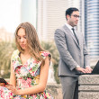 Young hipster couple in a phase of mutual disinterest and sadness - Concept of breaking up connected to the alienation from new technologies - Business man ignoring his girlfriend for working excess — Stock Photo #64499561