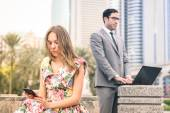 Young hipster couple in a phase of mutual disinterest and sadness - Concept of breaking up connected to the alienation from new technologies - Business man ignoring his girlfriend for working excess — Stock Photo