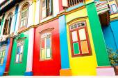 Tilted perspective of colorful house facade of ancient traditional buildings in Little India - World famous multicolored district in Singapore - Travel concept and sightseeing around asia destinations — Stock Photo