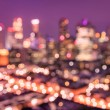 Bokeh filter of Singapore skyline from above during the blue hour - Asian modern city scape with spectacular nightscape panorama - Blurred defocused night lights on a violet marsala filtered editing — Stock Photo #68520375