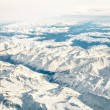 Aerial view of italian Alps with snow and misty horizon - Travel concept and winter vacation  on white snowy mountains - Trip wander to exclusive luxury destinations — Fotografia Stock  #68709195