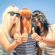 Group of young girlfriends with focus on colored funny hair and sunglasses - Concept of friendship and fun in the summer expressing positivity with thumbs up - Best friends sharing happiness together — Stock Photo #68709219