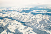 Aerial view of italian Alps with snow and misty horizon - Travel concept and winter vacation  on white snowy mountains - Trip wander to exclusive luxury destinations — Stock Photo