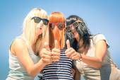 Group of young girlfriends with focus on colored funny hair and sunglasses - Concept of friendship and fun in the summer expressing positivity with thumbs up - Best friends sharing happiness together — Stock Photo