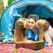 Group of best friends having fun camping together - Concept of carefree youth and freedom outdoors in the nature - Young people during vacations with lucky man flirting with beautiful girlfriends — Stock Photo #68778011