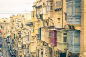 Typical buildings and balconies in La Valletta capital of mediterranean island of Malta - Vintage filtered look — Stock Photo