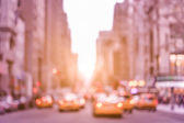 Rush hour with defocused yellow taxi cabs and traffic jam on 5th avenue in Manhattan downtown at sunset - Blurred bokeh postcard of New York City on a vintage marsala color filtered look — Stock Photo