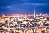 Bokeh of Auckland skyline from Mount Eden after sunset during the blue hour - New Zealand modern city with spectacular nightscape panorama - Blurred defocused night lights — Stock Photo