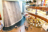 DUBAI, UAE - JANUARY 10, 2015: artistic waterfalls in Dubai Mall, the world's largest shopping mall. It is part of the 20 billion dollars Downtown Dubai Complex, and includes around 1,200 shops — Stock Photo