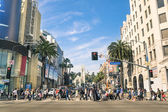 LOS ANGELES - MARCH 21, 2015: crowded street with multiracial people walking on Hollywood Boulevard the world famous Walk of Fame created in 1958 as a tribute to artists working in the movie industry. — Stock Photo