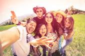 Best friends taking selfie at countryside picnic - Happy friendship concept and fun with young people and new technology trends - Vintage filter look with marsala color tones - Fisheye lens distorsion — Stock Photo