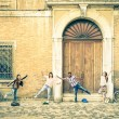 Young hipster best friends having fun posing in classic renaissance area - Youth concept and friendship with people alternative lifestyle - Guys and girls together in the city - Vintage filtered look — Stock Photo #72846633