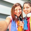Sporty girlfriends taking selfie during a break at run training in urban area - Sport Young happy women having fun together with fitness jogging workout - Fashion sport clothes and energetic drinks — Stock Photo #72846641