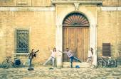 Young hipster best friends having fun posing in classic renaissance area - Youth concept and friendship with people alternative lifestyle - Guys and girls together in the city - Vintage filtered look — Stock Photo