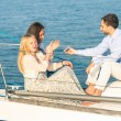 Young people having fun with smartphone on exclusive luxury sailing boat - Concept of friendship and travel with best friends interacting with new trends and technology - Late afternoon color tones — Stock Photo #73233911