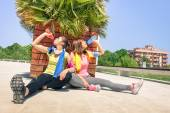 Sporty girlfriends drinking energetic juice during a break at run training in urban park area - Young happy women having fun together with fitness jogging exercise - Tilted horizon and warm color look — Stock Photo