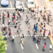 Blurred defocused abstract background of people walking on the street in Orchard Road in Singapore - Crowded city center during rush hour in urban business area zebra crossing - View from building top — Stock Photo #73793011